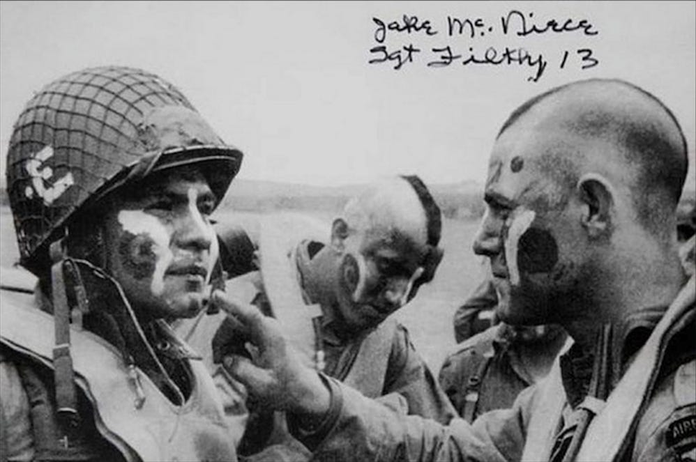 Members of the 101st Airborne Division apply war paint on D-Day