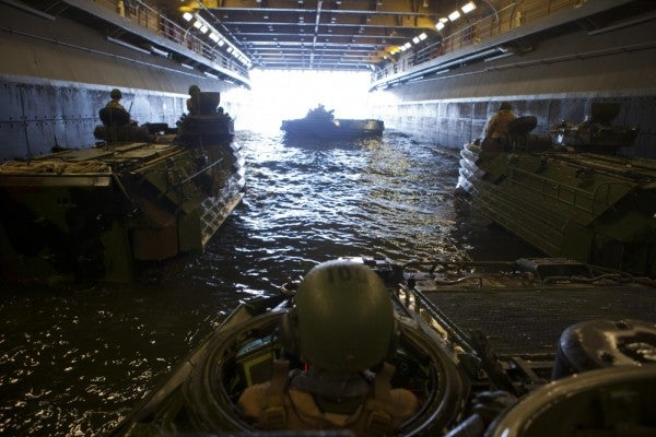 A Marine reflects on how a sinking amphibious assault vehicle symbolizes the entire Corps