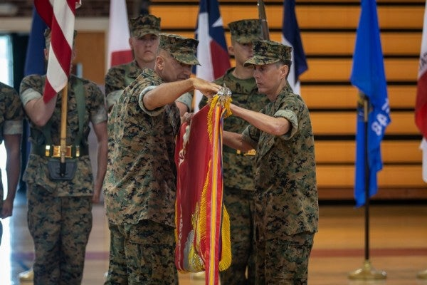 Four Marine units case their colors as sweeping reorganization takes effect