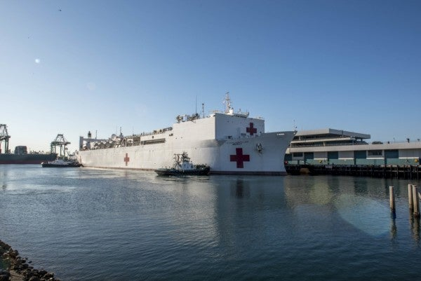 USNS Mercy has treated only 54 patients since arriving in LA. Now it's sending sailors ashore to help with COVID-19