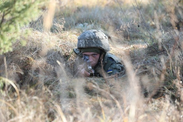 Ukrainian soldiers have to fight Russia and COVID-19 at the same time