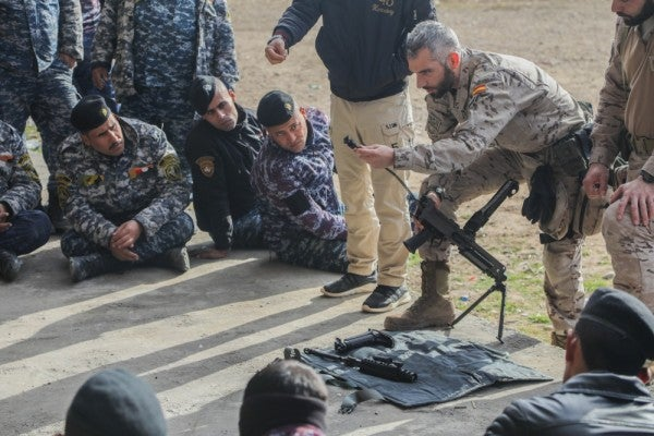 US-led coalition suspends training of Iraq forces over COVID-19