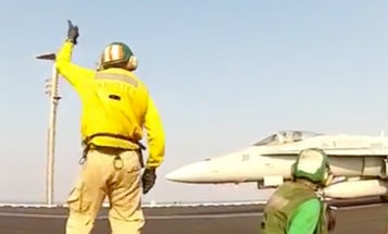 Hilarious Video Shows Navy Carrier Officers Having Way Too Much Fun Launching Aircraft