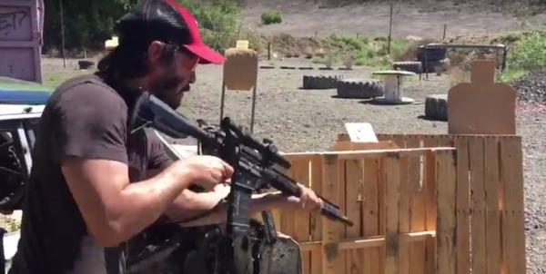 Watch Keanu Reeves Destroy This Gun Range