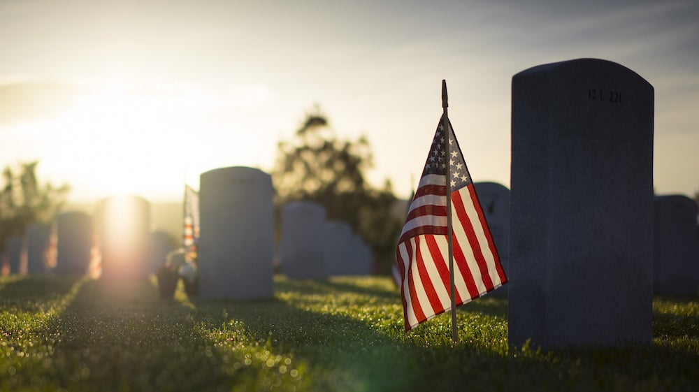 'It's another layer of grief' — Volunteers unable to place flags at national cemeteries this Memorial Day due to COVID-19