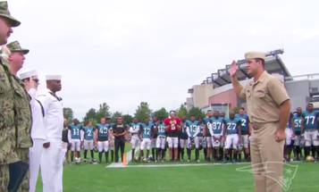 New England Patriots Player And Navy Ensign Performs Reenlistment Ceremony For Fellow Sailors