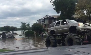 Watch A Pair Of 'Redneck' Monster Trucks Rescue A Military Vehicle Swamped By Harvey