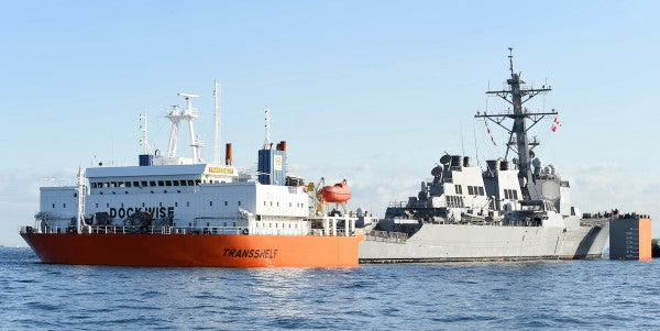 USS Fitzgerald Returns To Yokosuka After Suffering Damage During Loading Process