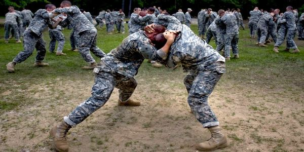 Army basic trainees practice hand-to-hand combat