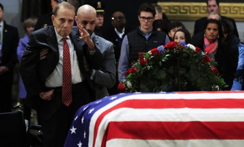 Watch Bob Dole Stand Up From His Wheelchair To Render A Final Salute To President George H.W. Bush