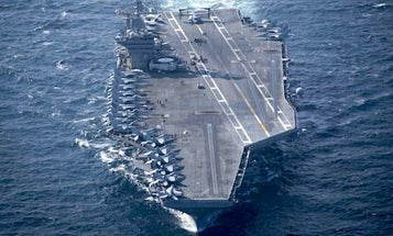 A US Aircraft Carrier Just Rolled Up In Persian Gulf Shadowed By Iranian Boats