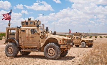 US military denies Syrian state media report that helicopters attacked a Syrian army checkpoint