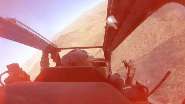 Awesome video shows Apache helicopters flying mere feet above the ground