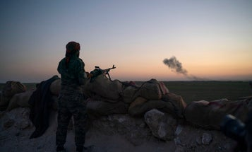 US-backed militia are working to evacuate civilians trapped by ISIS