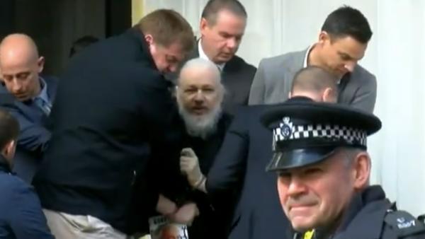 Watch Julian Assange, looking like bearded David Letterman, as he's arrested outside Ecuador's embassy
