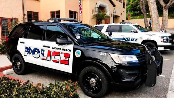 People in Laguna Beach, California are complaining the American flag on its cop cars is 'very aggressive'