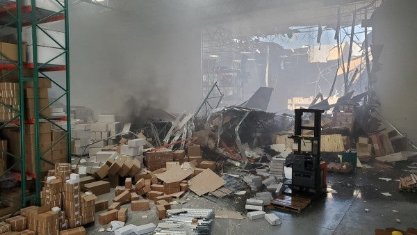 An F-16 fighter jet crashed into a warehouse in Southern California