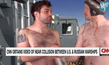 Shirtless Russian sailors casually sunbathe while their ship almost collides with US missile cruiser