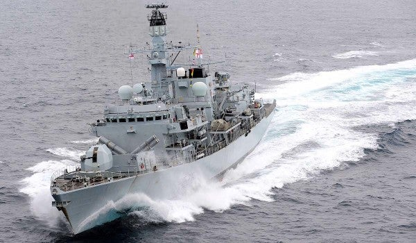 British warship wards off Iranian 'harassment' of oil tanker in the Gulf, US officials say