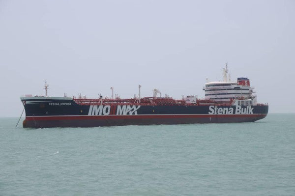 Iran warns UK against escalating tensions and says crew of seized ship safe