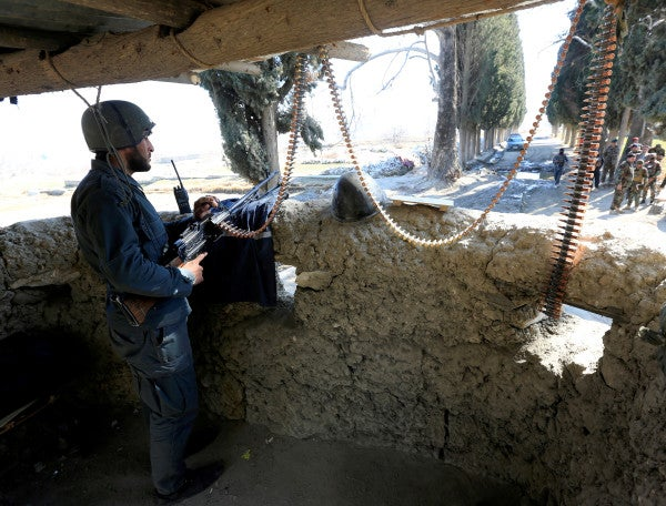 Taliban fighters attack Afghan forces on the first day of reduced violence period