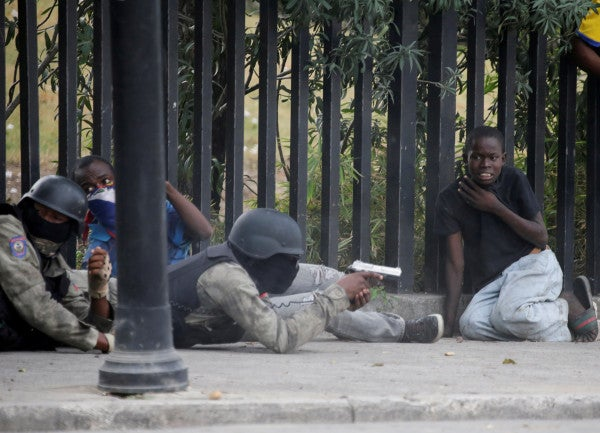 Haiti has an army and a police force. How did they end up shooting at each other?