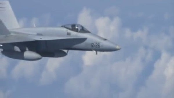 Watch a Russian jet chase a NATO fighter away from the Russian defense minister's aircraft
