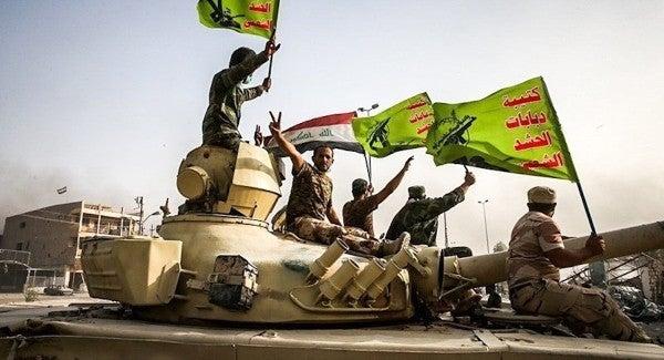 Iraqi paramilitary groups blame US, Israel for blasts at militia bases