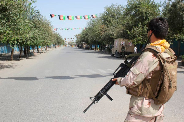 Taliban launches second attack on Afghan city while US envoy insists a peace deal is near
