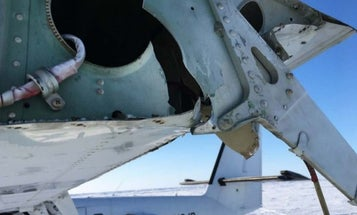 He was trying to photograph a plane takeoff during a Navy exercise. The plane ended up nailing his head