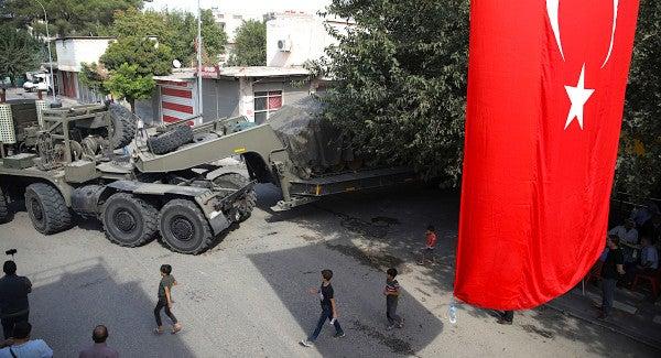 Russia-backed Syrian forces enter Kurdish-held region amid US retreat