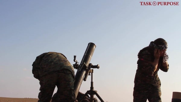 US bombs its own ammo dump in Syria as most troops beat a hasty retreat from the country