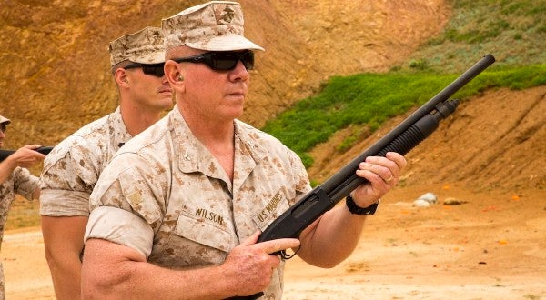 Marine colonel whose sexual assault conviction was tossed out will retire at a lower rank