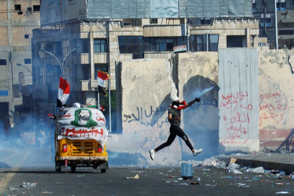 Iraqis take to the streets for the biggest day of protests since Saddam Hussein's rule