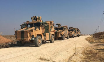 Turkey and Russia hold first joint patrol in northeast Syria