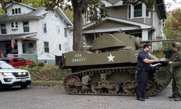 Here's a photo of a police officer pulling over a tank