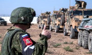 Russia established an air base in the Syrian city where withdrawing US troops were pelted with potatoes
