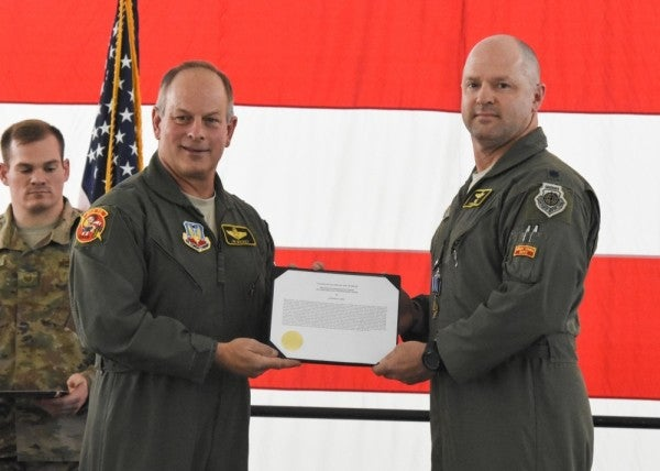 Two A-10 pilots receive the Distinguished Flying Cross for rescuing troops under heavy fire in Afghanistan