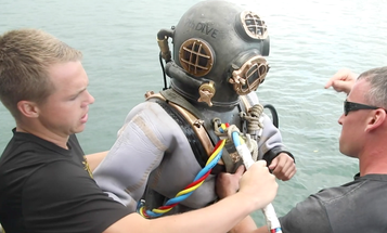 Army divers used WWII-era gear to inter a Pearl Harbor survivor aboard the sunken USS Arizona