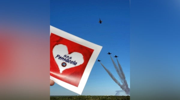 Blue Angels fly missing man formation in honor of Pensacola shooting victims
