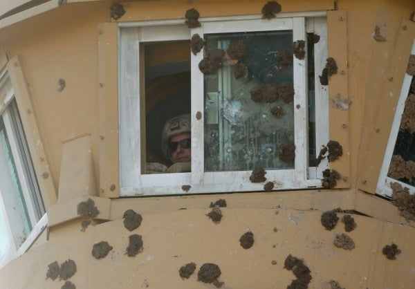 Rock-throwing Iraqi militias quit US embassy after protests