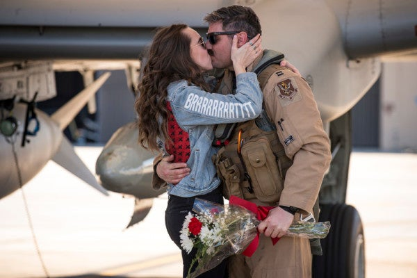 We salute the Air Force girlfriend with a 'BRRRT' jacket at an A-10 pilot's homecoming