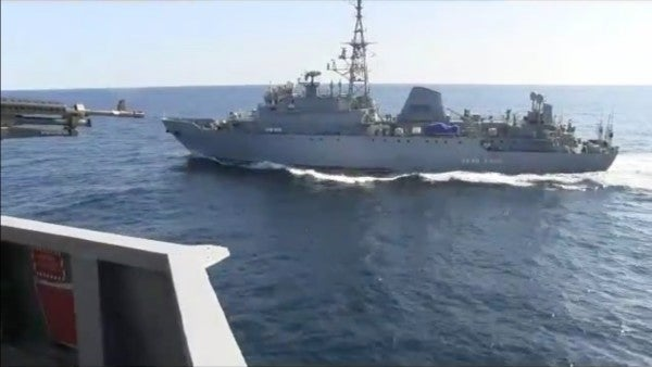 Videos show a Russian warship getting way too close to a US Navy destroyer in the Arabian Sea