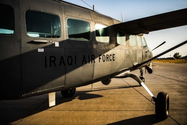 4 Iraqis wounded in attack on military base that houses US forces