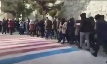 Video shows Iranian protesters refusing to walk on American and Israeli flags in Tehran