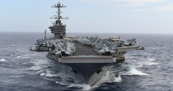 How should the Navy name its aircraft carriers?