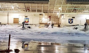 Yes, this is a helicopter hangar filled with foam, and no, this definitely wasn't supposed to happen