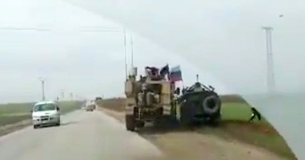 Video shows US military vehicle running a Russian military truck off the road in Syria