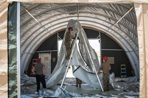 The Air Force is racing to build a field hospital to treat USS Theodore Roosevelt sailors sickened by COVID-19