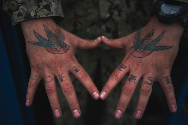 The Navy is considering opening tattoo parlors on its bases in Hawaii and Guam
